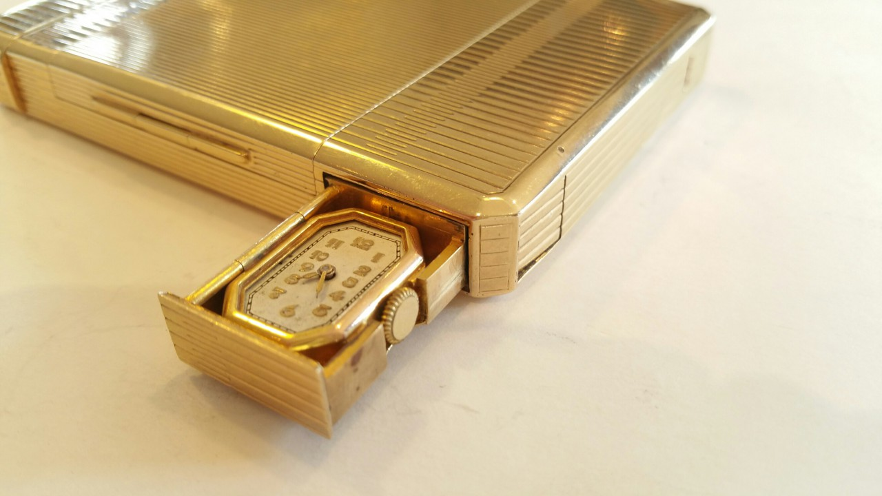 Dunhill compendium gold flip out watch