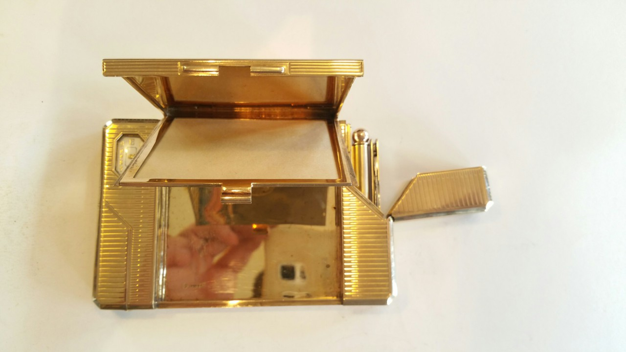 compendium ivory pad gold lighter